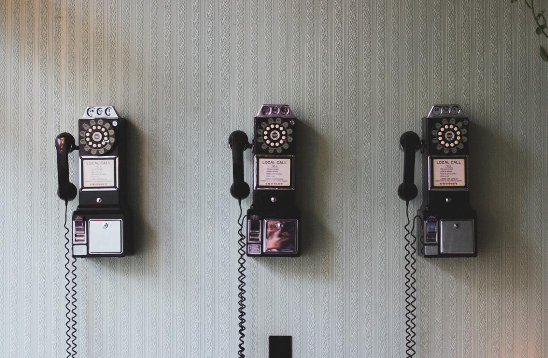 vintage telephones and the wall