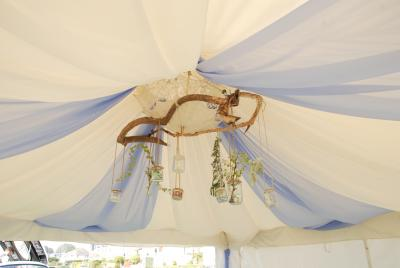 Classic Cream lining with Sky Blue voile draping and the Rustic chandelier